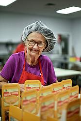 21 September 2015. New Orleans, Louisiana.<br /> Ms Anita packs Aunt Sally's Pralines.<br /> Photo©; Charlie Varley/varleypix.com