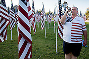 "10 SEPTEMBER 2011 - TEMPE, AZ:     MICHAEL WHITAKER, from Chandler, AZ, plays Taps in the ""Healing Field"" in Tempe Saturday. The ""Healing Field,"" a display of 2,996 flags, one for each person killed in the September 11 terrorists attacks on the World Trade Center in New York City and Washington DC, have become an annual tradition in Tempe, AZ. The event is sponsored by the National Exchange Club.     PHOTO BY JACK KURTZ"