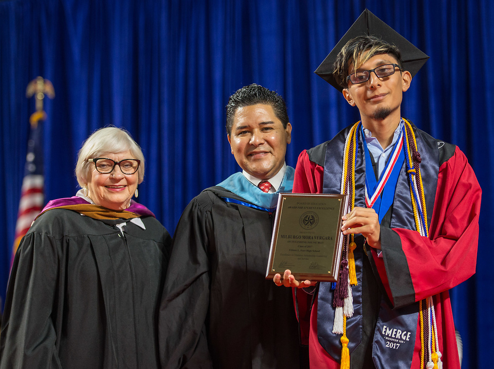 Houston ISD Superintendent Richard Carranza presents Milburgo Mora Vergara with a Board Award during the Furr / Reach High School graduation in Delmar Fieldhouse, May 26, 2017. The ceremony was the first graduation to be held in the newly constructed facility.