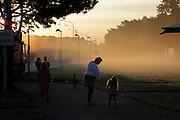 early morning mother with children at a highway rest stop in Belgium