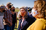03 SEPTEMBER 2020 - RADCLIFFE, IOWA: US Senator JONI ERNST (R-IA) campaigns for reelection during a farm event in central Iowa Thursday. She accompanied Sonny Perdue, the US Secretary of Agriculture, who made a secretarial disaster declaration for 42 counties in central Iowa. Perdue was accompanied by Governor Kim Reynolds Ernst. The secretarial disaster declaration frees up more federal funds, from the Department of Agriculture, to help in recovery from the derecho storm that wiped out about one-third of Iowa's corn crop on Monday, August 10, 2020. Many Iowa farmers are still rebuilding lost buildings or plowing under lost crops.       PHOTO BY JACK KURTZ