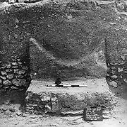 Altar with traces of burnt offerings in the inner hall of a temple at Sar, Temples of Dilmun, photograph, in the Bahrain National Museum, designed by Krohn and Hartvig Rasmussen, inaugurated December 1988 by Amir Shaikh Isa Bin Salman Al-Khalifa, in Manama, Bahrain. 5 temples have been excavated, at Sar, Diraz, Umm as-Sujur and Barbar, with architecture in the Sumerian Mesopotamian style. The museum houses cultural and archaeological collections covering 6000 years of history, with rooms entitled Burial Mounds, Dilmun, Tylos and Islam, Customs and Traditions, Traditional Trades and Crafts, and Documents and Manuscripts. Picture by Manuel Cohen