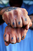 A mans hands with love and hate tattooed on them
