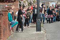 © Licensed to London News Pictures. 16/04/2017; Bristol, UK. Easter Day Egg Rolling contest on Vale Street in Totterdown, Bristol, the steepest street in the UK. Both children and adults took part in separate contests. Some eggs broke and others got stuck in the gutter. Photo credit : Simon Chapman/LNP
