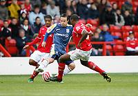 Photo: Richard Lane/Richard Lane Photography. Nottingham Forest v Cardiff City. Coca Cola Championship. 24/10/2008. Gavin Rae (C) turns Wes Morgan (R)