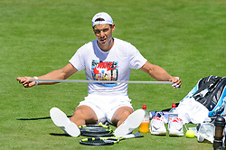 © Licensed to London News Pictures. 02/07/2017. Wimbledon, UK. Number 4 seed Rafael Nadal prepares a new racquet handle grip on final practice day  before the start of the tournament. Photo credit: Peter van den Berg/LNP