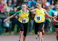 20 Aug 2016: Roise Nic Giolla Bhride, right, hands the baton to Ciara Ni Dhorchartaigh, who runs the final leg of Girls U14 4x100 Relay.   2016 Community Games National Festival 2016.  Athlone Institute of Technology, Athlone, Co. Westmeath. Picture: Caroline Quinn