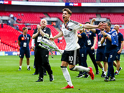 Free to use courtesy of Sky Bet. Tom Cairney runs out with the trophy as Fulham celebrate winning the game 0-1 to win the Sky Bet Championship Play-Off Final and secure Promotion to the Premier League - Rogan/JMP - 26/05/2018 - FOOTBALL - Wembley Stadium - London, England - Aston Villa v Fulham - Sky Bet Championship Play-Off Final.