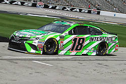 April 6, 2018 - Fort Worth, TX, U.S. - FORT WORTH, TX - APRIL 06: Monster Energy NASCAR Cup Series driver Kyle Busch (18) drives down pit road during practice for the O'Reilly Auto Parts 500 on April 6, 2018 at Texas Motor Speedway in Fort Worth, Texas.  (Photo by George Walker/Icon Sportswire) (Credit Image: © George Walker/Icon SMI via ZUMA Press)