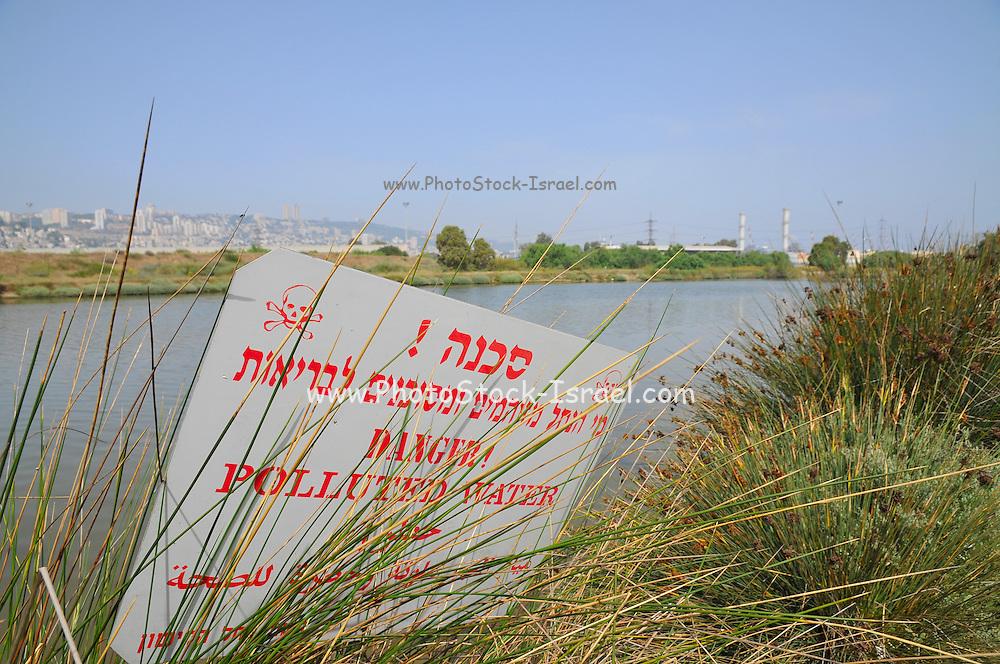 Israel, Bay of Haifa, Kishon River, with a pollution warning sign