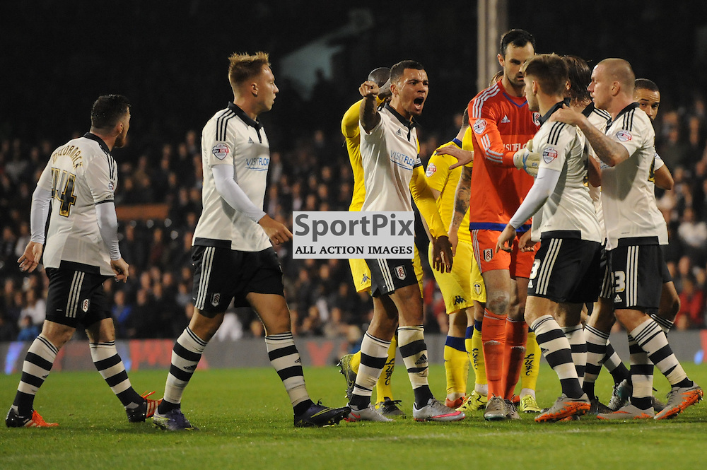 Fulhams Luke Garbatt is restrained by teamamtes after a push on Leeds Lewis Cook during Fulham v Leeds United game in the Sky Bet Championship at Craven Cottage on the 21st October 2015.