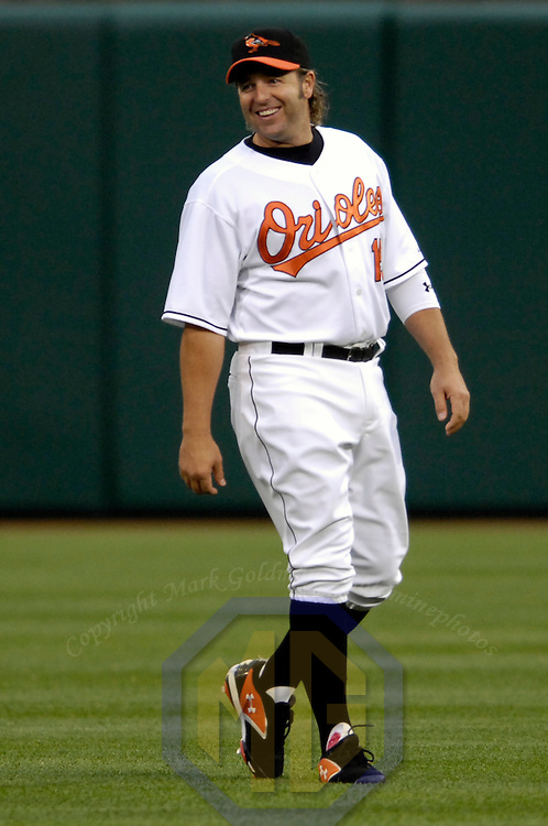 26 April 2007:  Baltimore Orioles first baseman Kevin Millar makes fun of the fuss regarding Baltimore Orioles announcer Gary Thorne's comments aired on Wednesday night that Curt Schilling's famous bloody sock had actually been colored with paint by showing the Boston Red Sox his right sock with red coloring on it.  The Red Sox defeated the Orioles 5-2 to sweep the Orioles in a two game series at Camden Yards in Baltimore, MD.
