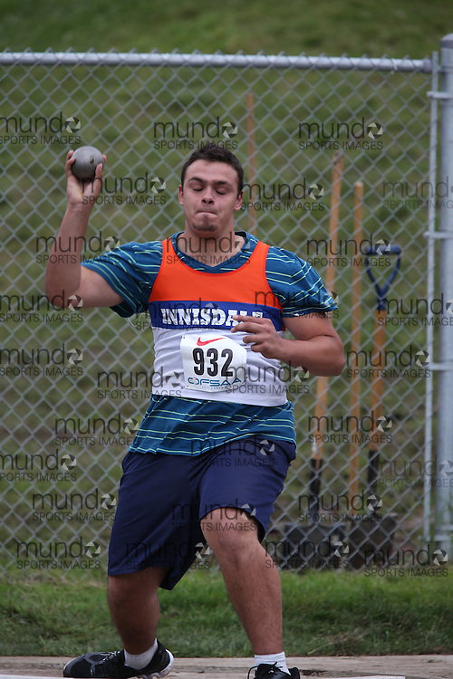 Curtis Gillan of Innisdale SS - Barrie competes in the midget boys shot put at the 2013 OFSAA Track and Field Championship in Oshawa Ontario, Thursday,  June 6, 2013.<br /> Mundo Sport Images / Sean Burges