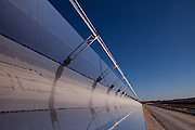 """La Dehesa solar power plant. La Dehesa, 50 MW parabolic through solar thermal power plant with molten salts storage. Completed in February 2011, it is located in La Garovilla (Badajoz), Spain, and it is owned by Renovables SAMCA. With an annual production of 160 million kwh, La Dehesa will be able to cover the electricity needs of more than 45,000 homes, preventing the emission of 160,000 tons of carbon. The 220 h plant has 225,792 mirrors arranged in rows and 672 solar collectors wich occupy a total length of 100km."""",""""- solar field formed by the fluid and the fluid circulation system."""