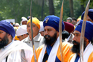 "Rome April 30 2006  .Piazza Vittorio  .Sikh ""Punj Pyare"" (Five Beloved Ones) lead a religious parade.The parade is for Visaki, a traditional Sikh celebration.."