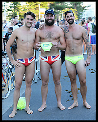 Three men wearing 'Budgie smuggler' swimming trunks wait for the arrival of the Duke and Duchess of Cambridge at Manly Beach in Sydney, Australia,  Friday, 18th April 2014. Picture by Stephen Lock / i-Images