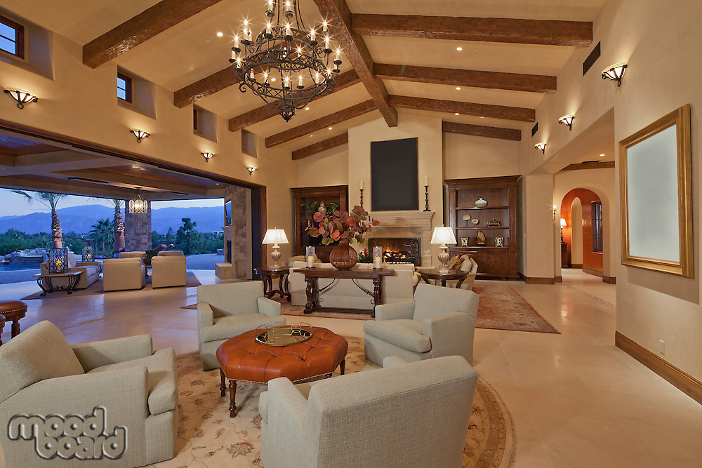 Interior of large open plan living room opening to patio