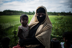 On the road near Ukhia, Bangladesh. A Rohingya woman is on the way to the refugee camp with her sick baby.<br />