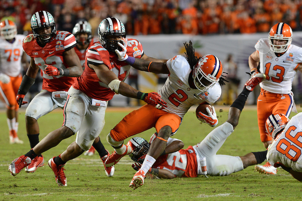 January 3, 2014: Sammy Watkins #2 of Clemson tries to avoid the tackle by Joshua Perry #37 of Ohio State during the NCAA football game between the Clemson Tigers and the Ohio State Buckeyes at the 2014 Orange Bowl in Miami Gardens, Florida. The Tigers defeated the Buckeyes 40-35.