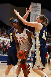 March 19, 2011; Stanford, CA, USA; Stanford Cardinal forward Chiney Ogwumike (13) shoots between UC Davis Aggies guard Hannah Stephens (5) and forward/center Lauren Juric (23) during the first half of the first round of the 2011 NCAA women's basketball tournament at Maples Pavilion.