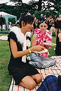 Two girls eating a picnic, Posh at Addington Palace, UK, August, 2004