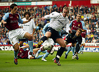 Photograph: Scott Heavey.<br />Aston Villa v Bolton Wanderers. FA Baclaycard Premiership. 05/10/2003.<br />Kevin Nolan (Right) tries to control ahead of Peter Whittingham after Thomas Sorensen dropped the cross.