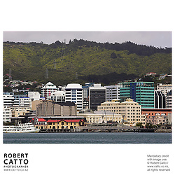 Boatsheds, Michael Fowler Centre and Wellington Town Hall seen from Lambton Harbour, Wellington, New Zealand.<br />