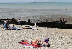Image licensed to i-Images Picture Agency. 21/06/2014. Whitstable, United Kingdom.  A couple enjoy the hot weather at Whitstable in Kent.  Picture by Stephen Lock / i-Images