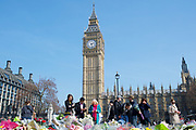 Floral tributes to the people murdered in the terrorist attack by Khalid Masood laid out in Westminster Square overshadowed by Big Ben.<br /> (Westminster terror attack 22nd March 2017)<br /> <br /> 27th March 2017 <br /> Westminster, London, Great Britain <br /> <br /> Photograph by Elliott Franks <br /> Image licensed to Elliott Franks Photography Services