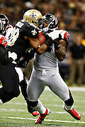 NEW ORLEANS, LA - NOVEMBER 11:  Akeem Dent #52 of the Atlanta Falcons tackles Mark Ingram #28 of the New Orleans Saints at Mercedes-Benz Superdome on November 11, 2012 in New Orleans, Louisiana.  The Saints defeated the Falcons 31-27.  (Photo by Wesley Hitt/Getty Images) *** Local Caption *** Akeem Dent; Mark Ingram