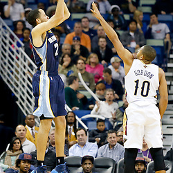 Dec 13, 2013; New Orleans, LA, USA; Memphis Grizzlies small forward Tayshaun Prince (21) shoots over New Orleans Pelicans shooting guard Eric Gordon (10) during the first half of a game at New Orleans Arena. Mandatory Credit: Derick E. Hingle-USA TODAY Sports
