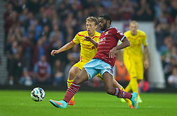 LONDON, ENGLAND - Saturday, September 20, 2014: Liverpool's Lucas Leiva in action against West Ham United's Alex Song during the Premier League match at Upton Park. (Pic by David Rawcliffe/Propaganda)