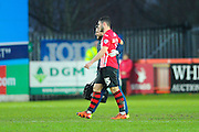 Exeter City's Jordan Moore-Taylor is helped off the pitch after picking up an injury during the Sky Bet League 2 match between Exeter City and Accrington Stanley at St James' Park, Exeter, England on 23 January 2016. Photo by Graham Hunt.