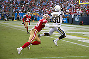 Los Angeles Chargers running back Austin Ekeler (30) is chased by San Francisco 49ers rookie linebacker Fred Warner (48) as he leaps and catches a 22 yard second quarter touchdown pass that cuts the San Francisco 49ers lead to 17-14 before halftime during the NFL week 4 regular season football game against the San Francisco 49ers on Sunday, Sept. 30, 2018 in Carson, Calif. The Chargers won the game 29-27. (©Paul Anthony Spinelli)