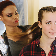 PROVIDENCE, RI - FEB 16: Model Ominique Burrows does double duty as a hair stylist, braiding Kat Thomas' hair backstage prior to the K-Bobby International show during StyleWeek NorthEast on February 16, 2015 in Providence, Rhode Island. (Photo by Cat Laine)