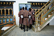 Thimphu, Bhutan. Students looking at the schedule of the examinations at the National Institute of Zorig Chusum, a school of arts that trains students in Bhutan's 13 traditional arts and crafts.