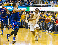 West Virginia Mountaineers guard Juwan Staten (3) drives down for the game winning shot against the Kansas Jayhawks during the second half at the WVU Coliseum.
