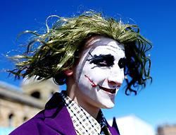 © Licensed to London News Pictures. 10/04/2016. Scarborough, UK.  A man dressed as The Joker from Batman takes part in Scarborough Sci-fi Convention held this weekend at the Spa building, South Bay, Scarborough.  Photo credit: Ian Forsyth/LNP