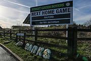 Flowers in memory of U'18's manager Chris Barker during the EFL Sky Bet League 2 match between Forest Green Rovers and Salford City at the New Lawn, Forest Green, United Kingdom on 18 January 2020.