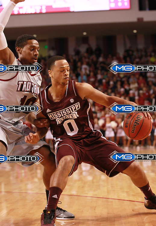 Nov 9, 2012; Troy, AL, USA; MIssissippi State Bulldogs guard Jalen Steele (0) drives to the basket as Troy Trojans guard Emil JOnes (10) defends at Trojan Arena. Mandatory Credit: Marvin Gentry-