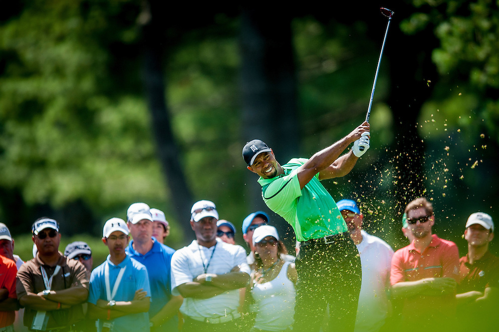 Tiger Woods tees off on the 2nd hole during the first round of the Quicken Loans National golf tournament on Wednesday at Congressional Country Club in Bethesda, Maryland. This marked  Woods' return to competition for the first time in three months after having surgery just a week before the Masters in April of this year.