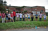 Rally for Healthy  Neighborhood held by residents of Gordon Plaza and their supporters. They demand a fully funded relocation from their homes built on top of a former toxic dump, on land the city sold them. The protesters hold hands in front of the Moton Elementary School, which is also built on toxic land over the Agricultural Street Landfill.