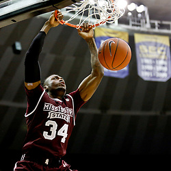 Jan 7, 2017; Baton Rouge, LA, USA; Mississippi State Bulldogs center Schnider Herard (34) dunks against the LSU Tigers during the first half of a game at the Pete Maravich Assembly Center. Mandatory Credit: Derick E. Hingle-USA TODAY Sports