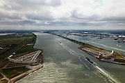 Nederland, Zuid-Holland, Nieuwe Waterweg, 22-05-2011; Maeslantkering in de Nieuwe Waterweg, gezien naar Rotterdam. De stormvloedkering bestaat uit twee deuren die klaar liggen in een dok en welke sluiten bij een waterstand van 3 meter of meer boven NAP. De kering, laatst voltooide onderdeel van Deltawerken, beschermt Rotterdam en achterland bij extreme waterstanden..The new storm surge barrier (Maeslantkering) in the Nieuwe Waterweg (New Waterway), the entrance to the port of Rotterdam (at the horizon)..In case of storm floods, the two enormous doors will close of the waterway protecting Rotterdam and its hinterland.luchtfoto (toeslag); aerial photo (additional fee required).foto Siebe Swart / photo Siebe SwartSwart.Nederland, Provincie, Plaats, 10-01-2011;.QQQ.luchtfoto (toeslag), aerial photo (additional fee required).foto/photo Siebe Swart