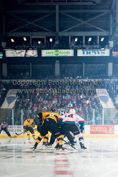 KELOWNA, CANADA - MAY 13: The Brandon Wheat Kings face off against the Kelowna Rockets on May 13, 2015 during game 4 of the WHL final series at Prospera Place in Kelowna, British Columbia, Canada.  (Photo by Marissa Baecker/Shoot the Breeze)  *** Local Caption ***
