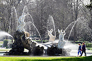 © Licensed to London News Pictures. 07/04/2015. Maidenhead, UK. People walk past the Shell Fountain, known as the Fountain of Love. People enjoy the warm and sunny weather at Cliveden House in Maidenhead Buckinghamshire today 7th April 2015. Photo credit : Stephen Simpson/LNP