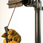 Electrode position when welding a T-joint in the overhead position. <br /> <br /> Shielded metal arc welding (SMAW), or informally as stick welding, is a manual arc welding process that uses a consumable electrode coated in flux to lay the weld. An electric current, in the form of either alternating current or direct current from a welding power supply, is used to form an electric arc between the electrode and the metals to be joined.