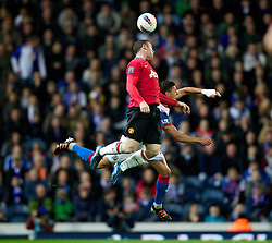 BLACKBURN, ENGLAND - Monday, April 2, 2012: Manchester United's Wayne Rooney in action against Blackburn Rovers's Jason Lowe during the Premiership match at Ewood Park. (Pic by Vegard Grott/Propaganda)