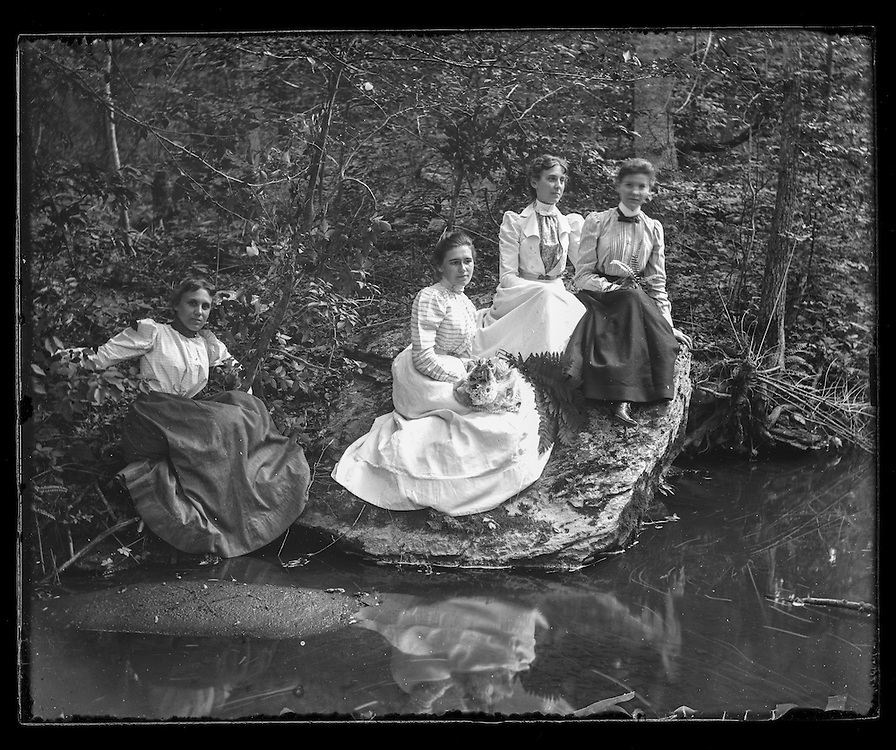 Victorian photograph of four women in the woods next to the water in Fallston, Maryland.