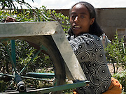 Caada Jemam, 20, on her farm in Zwei, Ethiopia, where they grow seedlings to sell on to larger farms. Using the water from their new well they are able to start plants growing much earlier than the normal growing season.